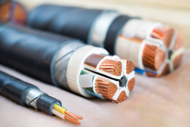 Cross section of high-voltage cable Cross section of high-voltage cable. Thick copper veins are surrounded by a thick layer of polymer insulation. distribution center stock pictures, royalty-free photos & images
