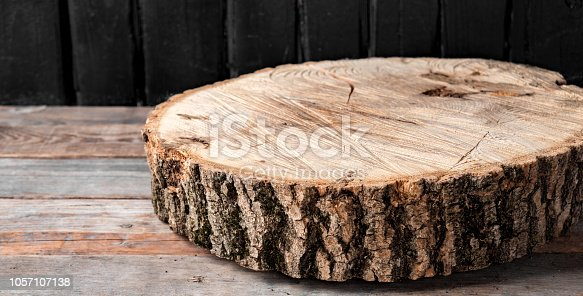 istock cross section of the big old tree on a rustic table 1057107138