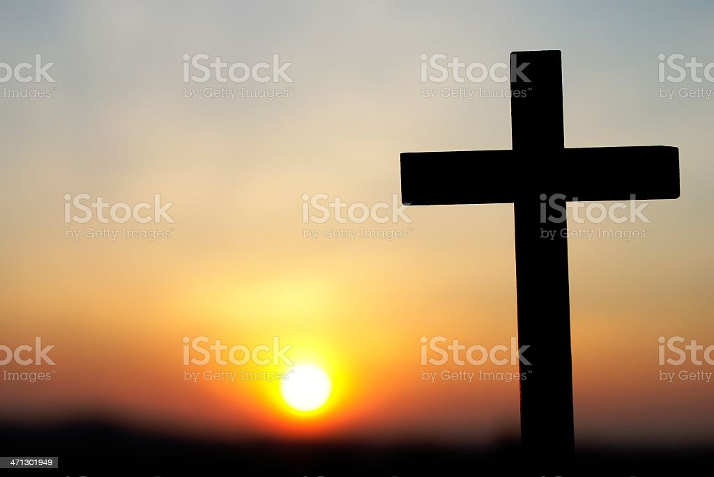 Cross silhouette against the sunset royalty-free stock photo