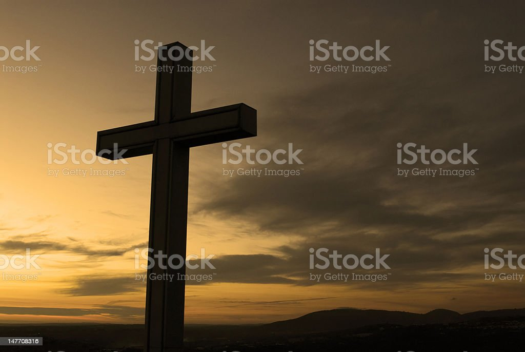 Cross silhouette and the clouds at sunset royalty-free stock photo