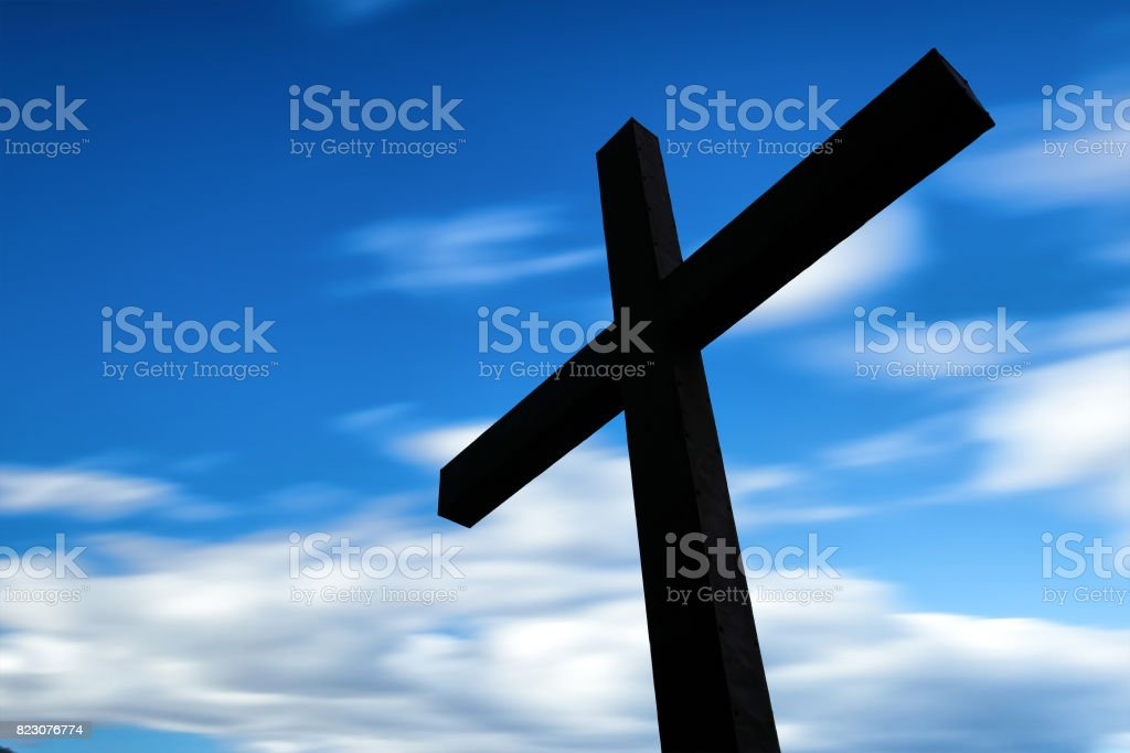 Cross silhouette and the clouds stock photo