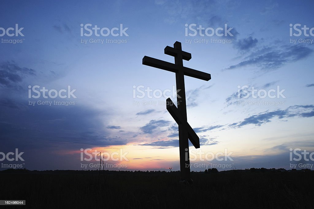 cross silhouette with the sunset royalty-free stock photo