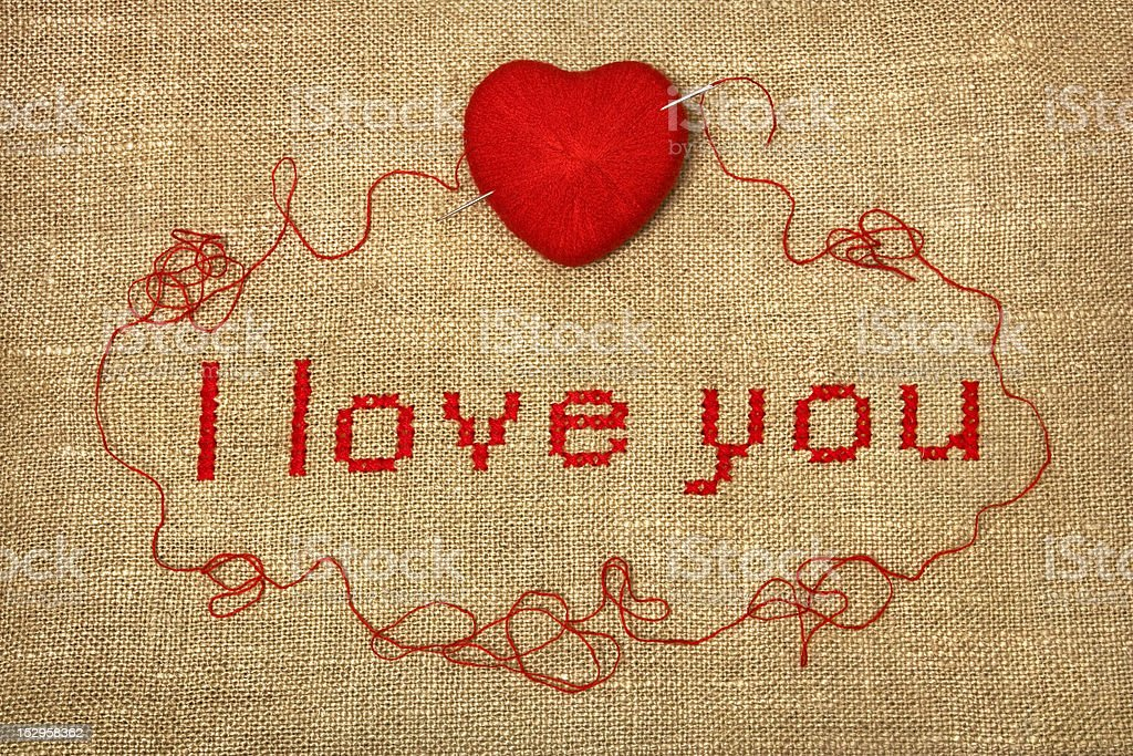 Cross stich 'I love you' with knit ball royalty-free stock photo