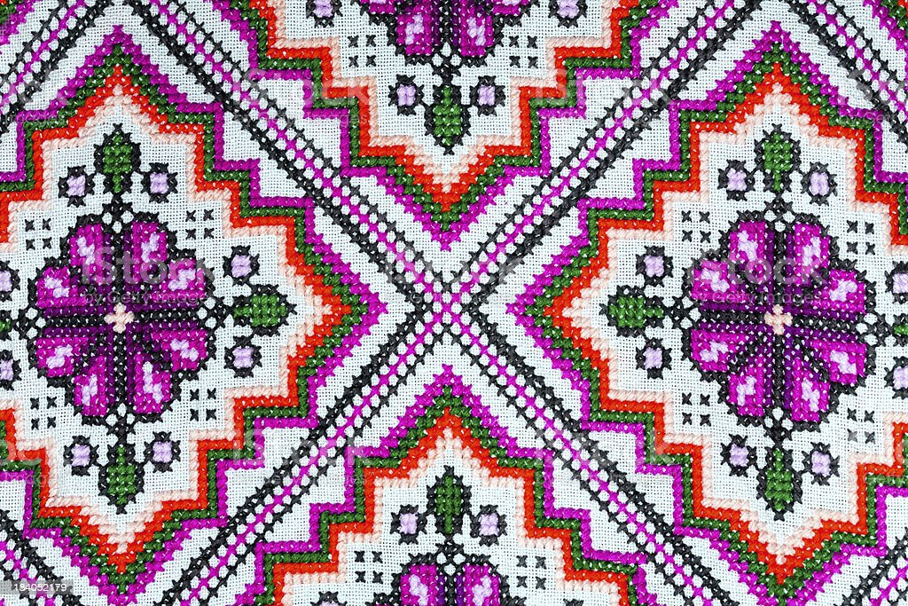 Cross stitch embroidery on canvas. royalty-free stock photo