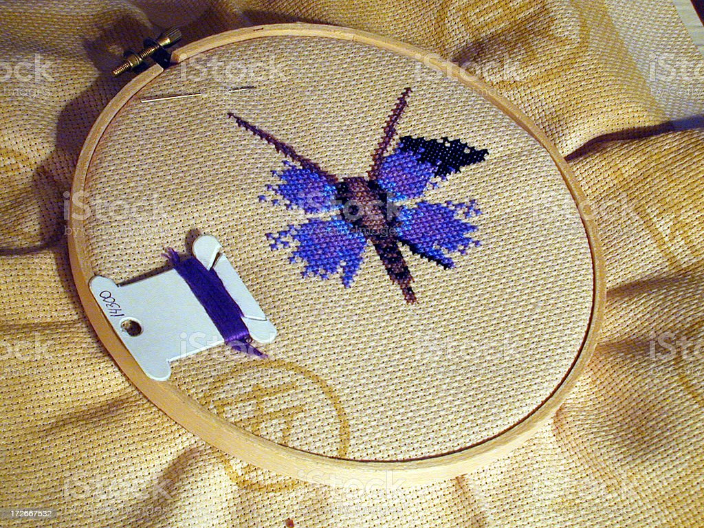 Cross stitching a butterfly royalty-free stock photo