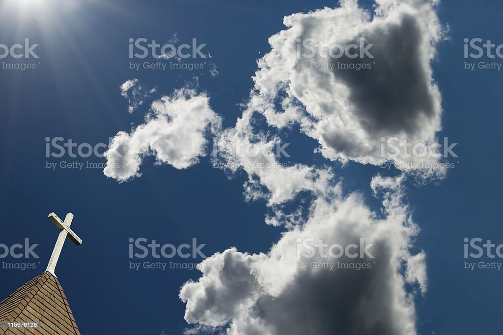 Cross, Sun Rays, and clouds royalty-free stock photo