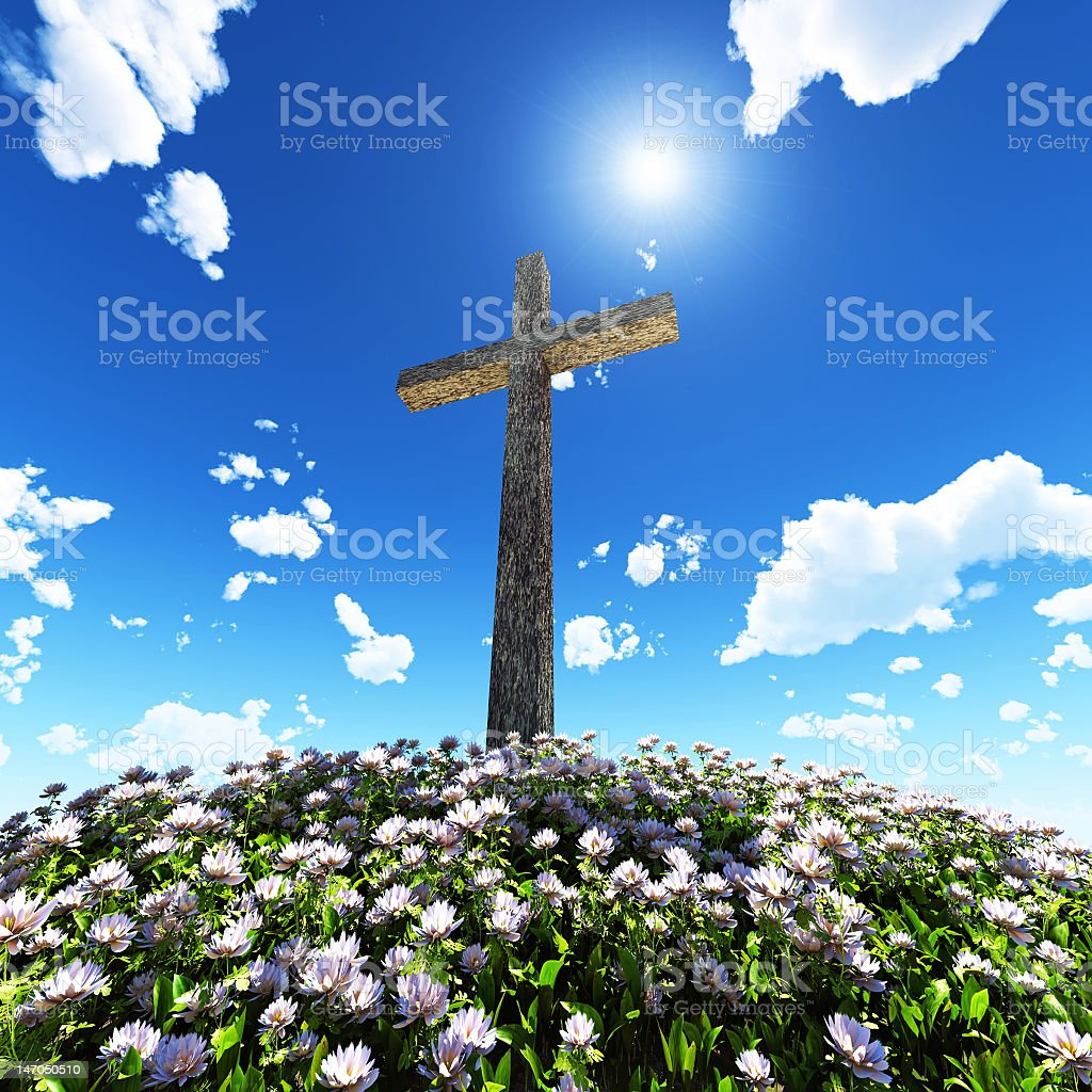 cross surrounded by flowers royalty-free stock photo