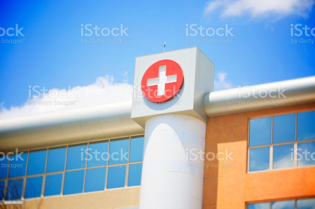 Cross symbol on hospital building stock photo