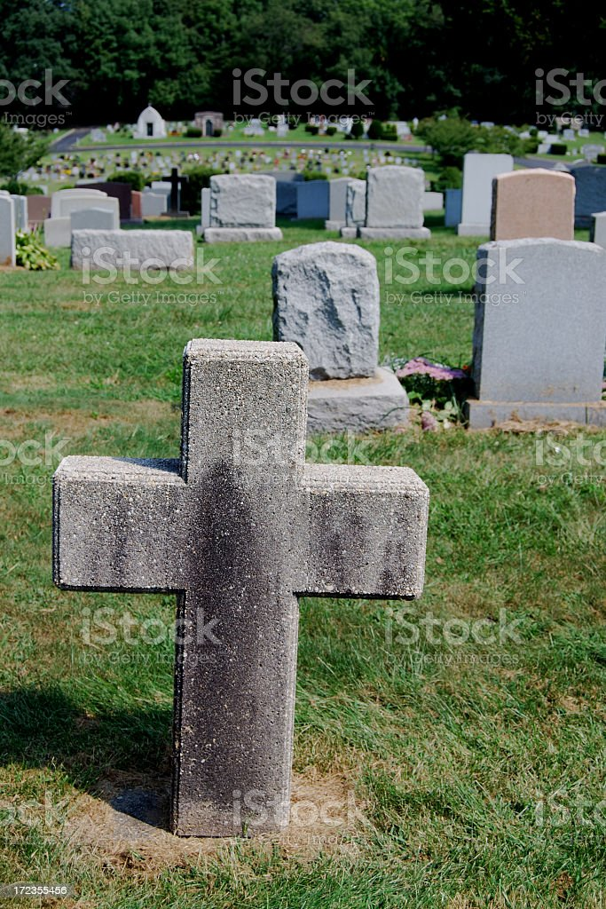 Cross Tombstone In A Cemetery royalty-free stock photo