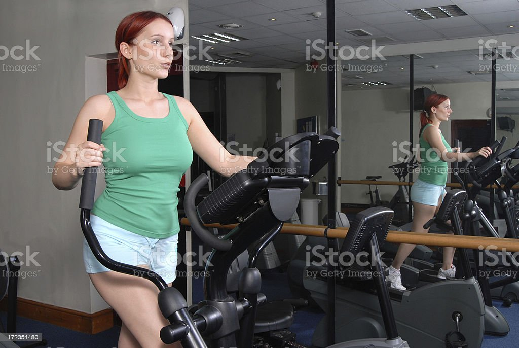 Cross trainer exercising royalty-free stock photo