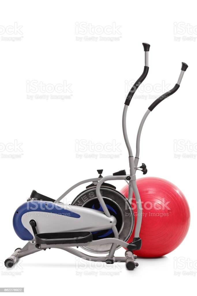 Cross trainer machine and a pilates ball stock photo