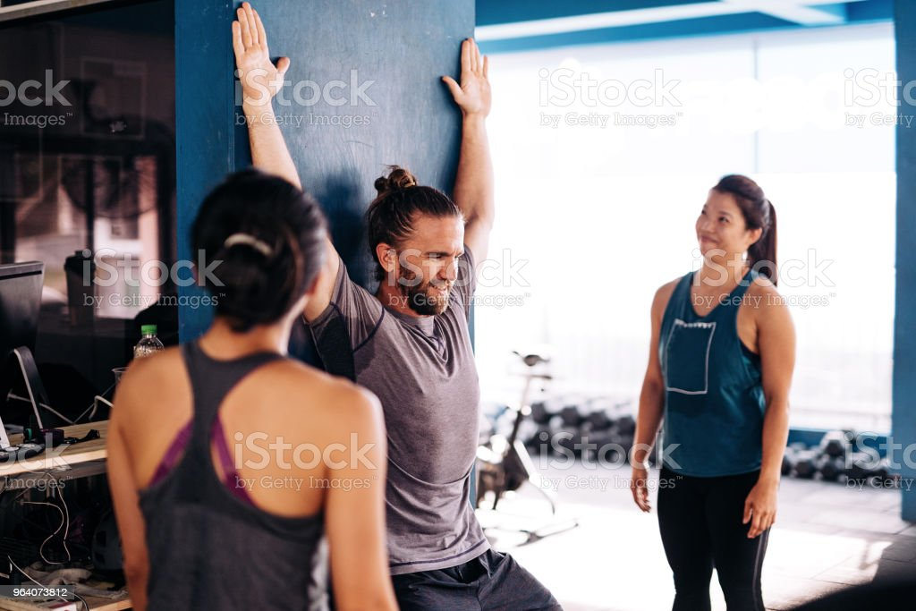 Cross training and stretching - Royalty-free 20-29 Years Stock Photo