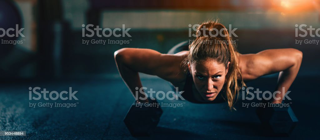 Cross training fitness. Young woman exercising stock photo