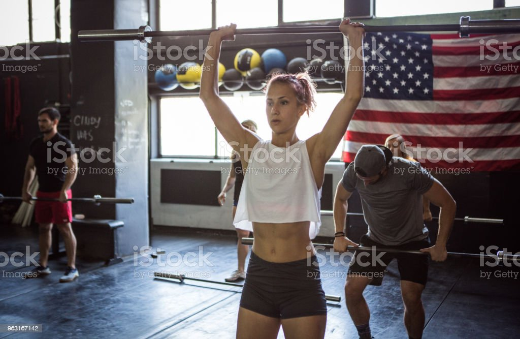 Cross training in gym stock photo