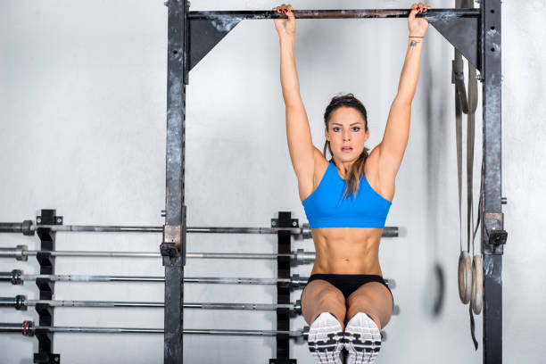 Cross training & woman on gymnastic bar stock photo