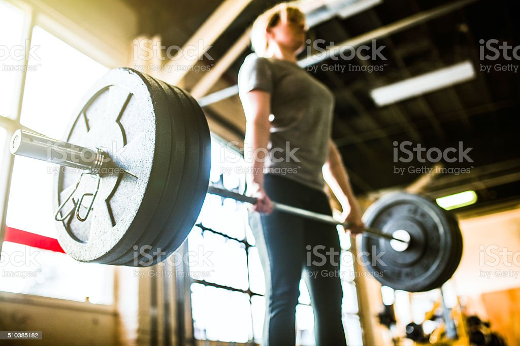 Cross Training Woman Performing Deadlift stock photo