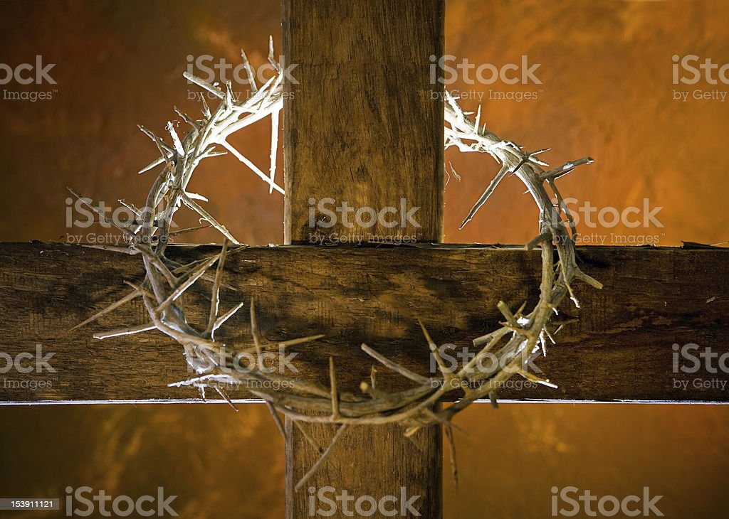 Cross with a crown of thorns in orange stock photo