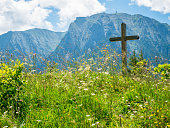A cross with Bucegi Mountains in the background. Beutiful landscape with Carpathian Mountains in Romania.