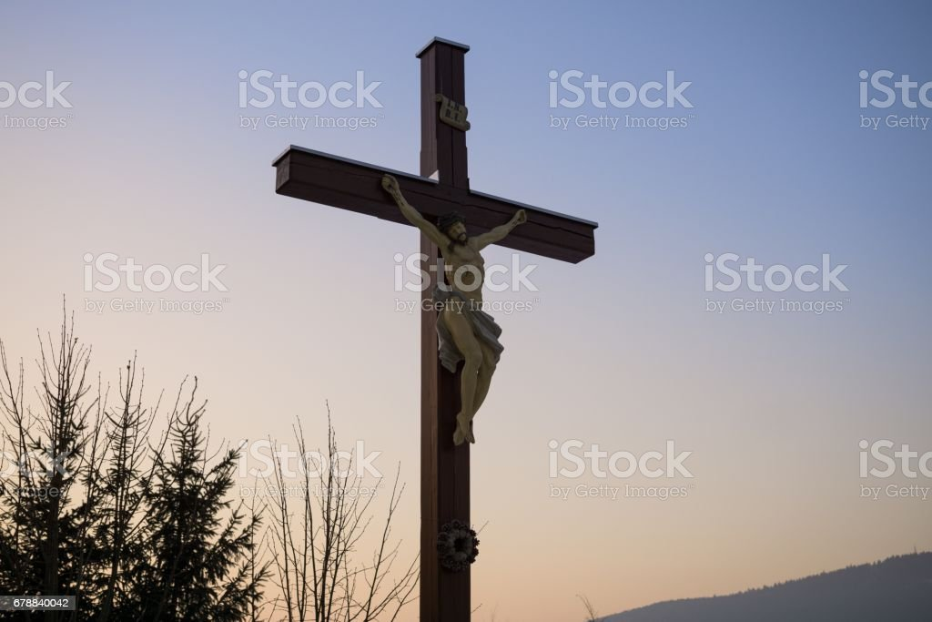Cross with Christ during sunset. stock photo