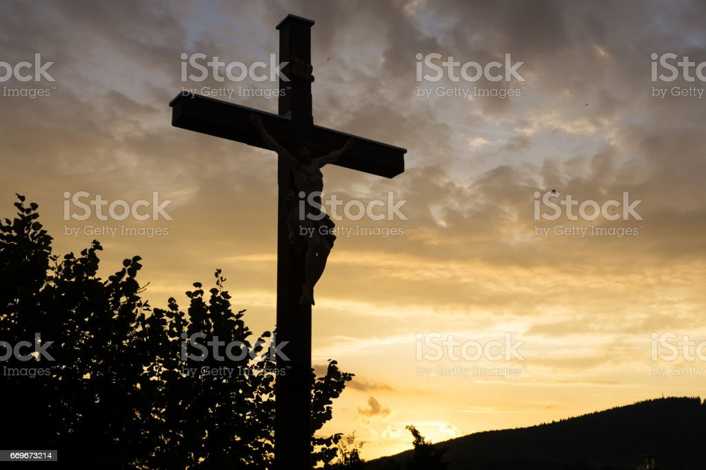 Cross with Christ during sunset. Slovakia stock photo