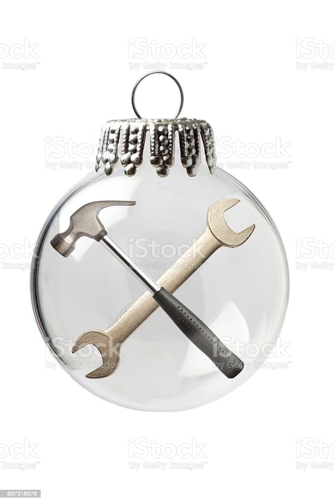 Cross with Hammer and a Spanner in a Christmas Ornament - Stock image . - Cross With Hammer And A Spanner In A Christmas Ornament Stock Photo