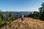 istock Crossbow hunters hiking 1280238169