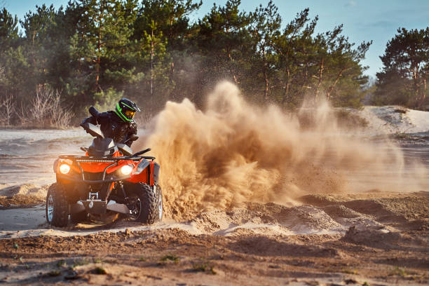Cross-country quad bike race, extreme sports stock photo