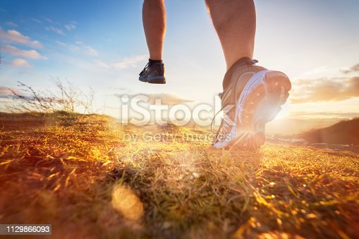 istock Cross-country running in early morning sunrise 1129866093