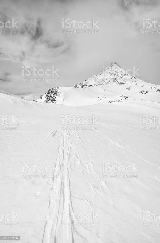 Cross-country ski tracks towards a mountain peak in Jotunheimen stock photo