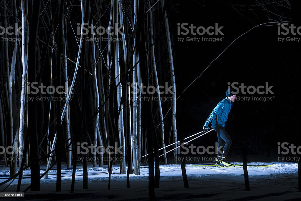 Cross-country skier at night stock photo