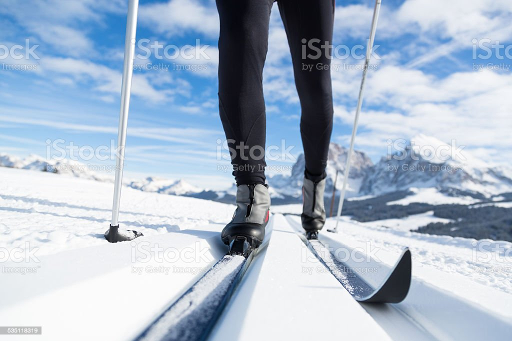 Close-up of a mans legs doing cross-country skiing.