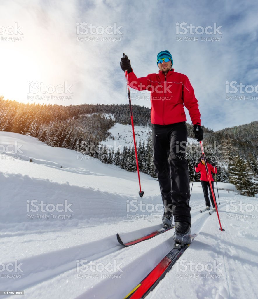 Cross-country skiing. Young man and woman doing exercise stock photo