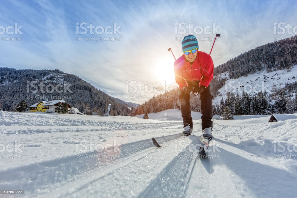 Cross-country skiing. Young man doing exercise stock photo