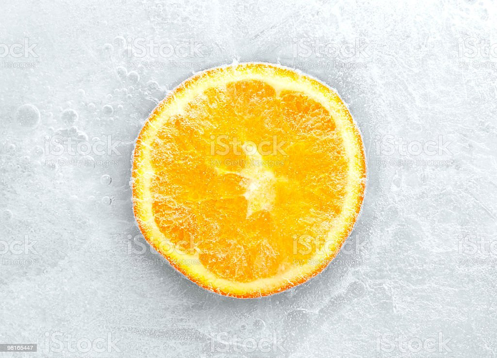 Crosscut of an orange frozen inside of ice royalty-free stock photo