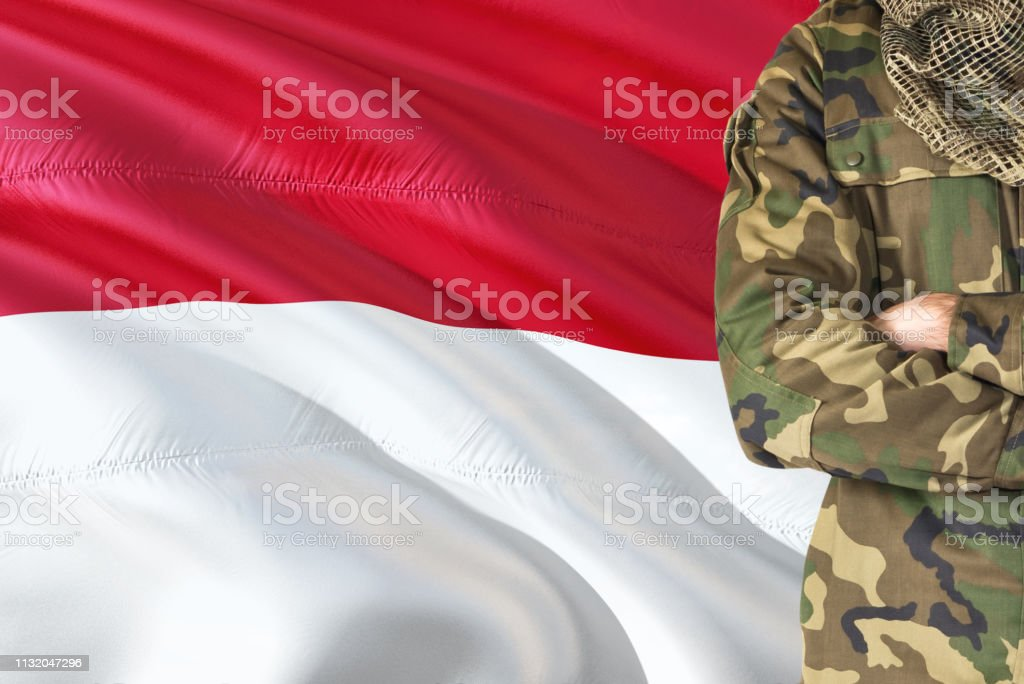 Crossed Arms Indonesian Soldier With National Waving Flag On Background Indonesia Military Theme Stock Photo Download Image Now Istock