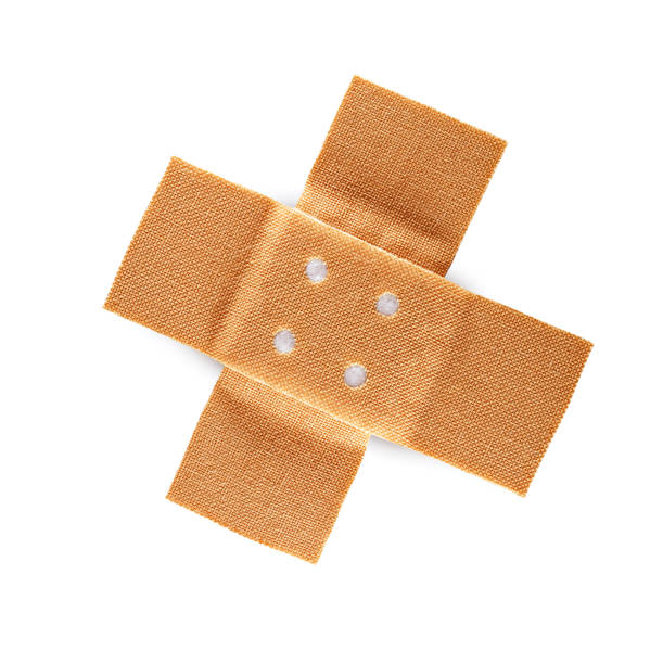 crossed band-aid stock photo