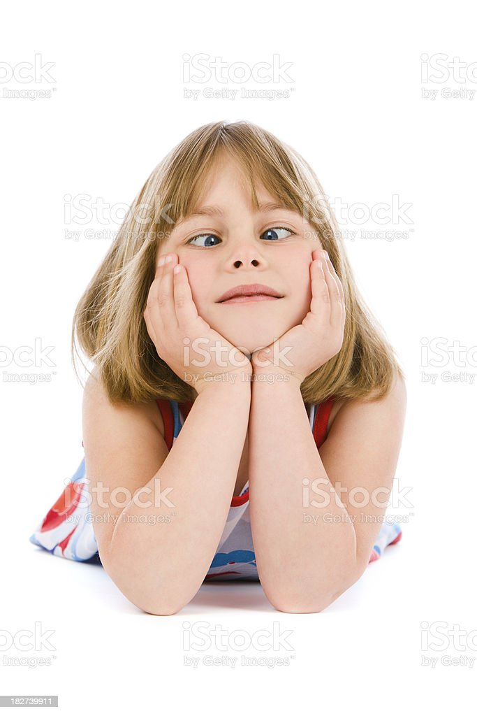 Crossed eyed girl pulling face on white background royalty-free stock photo