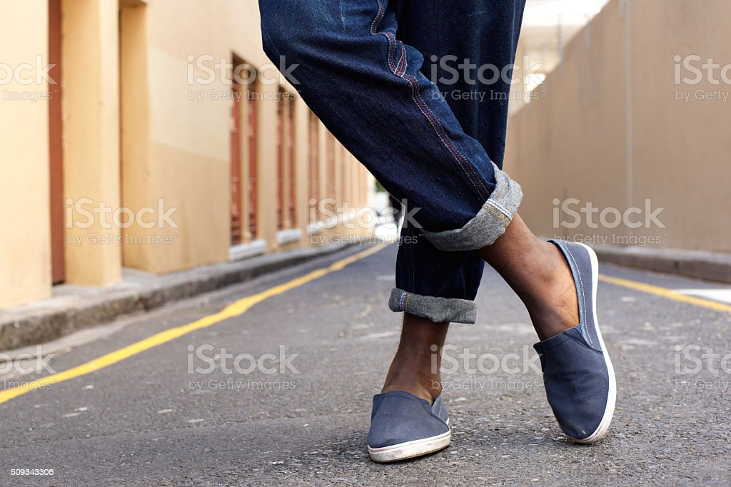 Crossed legs and shoes stock photo
