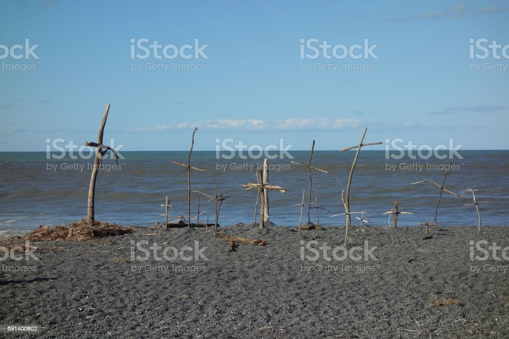 Crosses made from Driftwood on the Beach stock photo