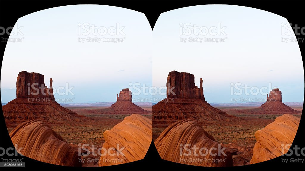 VR cross-eyed 3D headset view caves Monument Valley, sunset stock photo