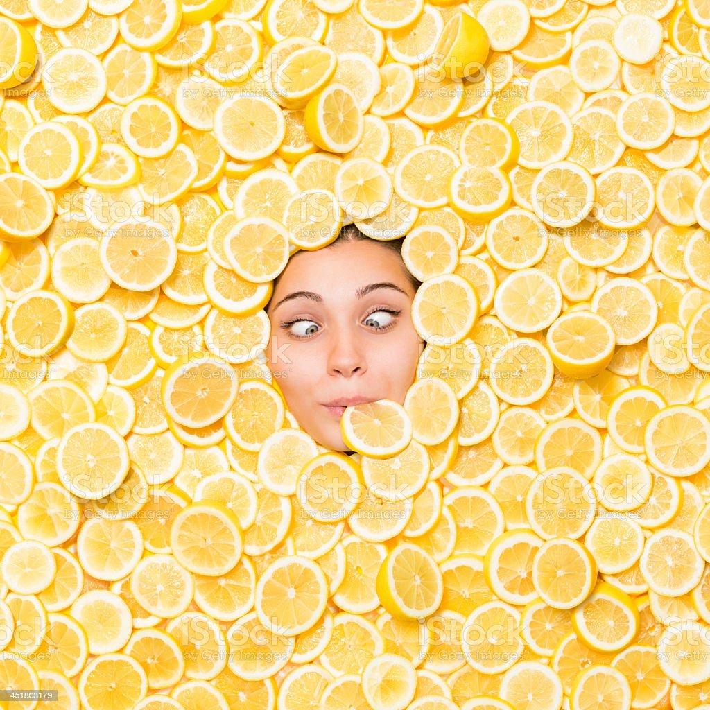 Cross-eyed Woman Surrounded With Lemon Slice stock photo