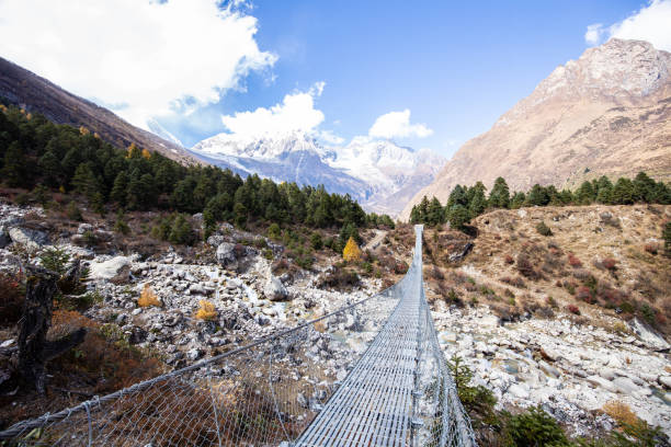 Crossing a bridge on the Manaslu circuit, Nepal stock photo