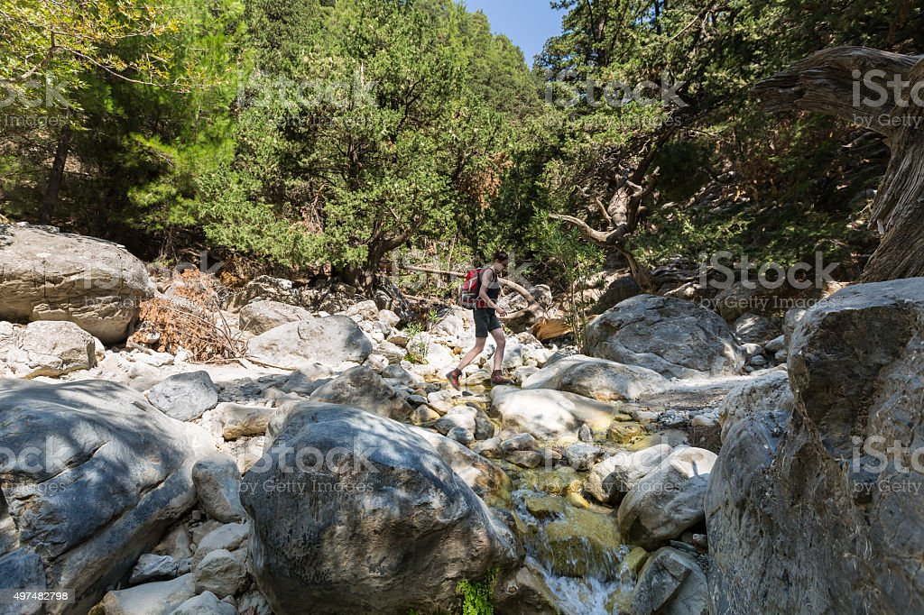Crossing a little creek in Samaria Gorge, Crete stock photo