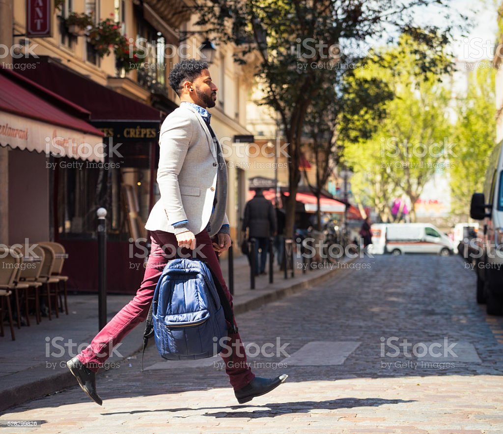 Crossing a Paris street in a hurry stock photo