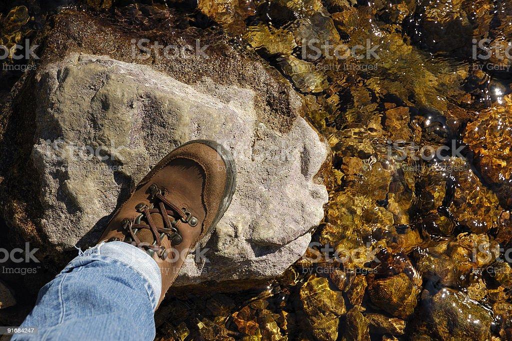 Crossing a stream stock photo