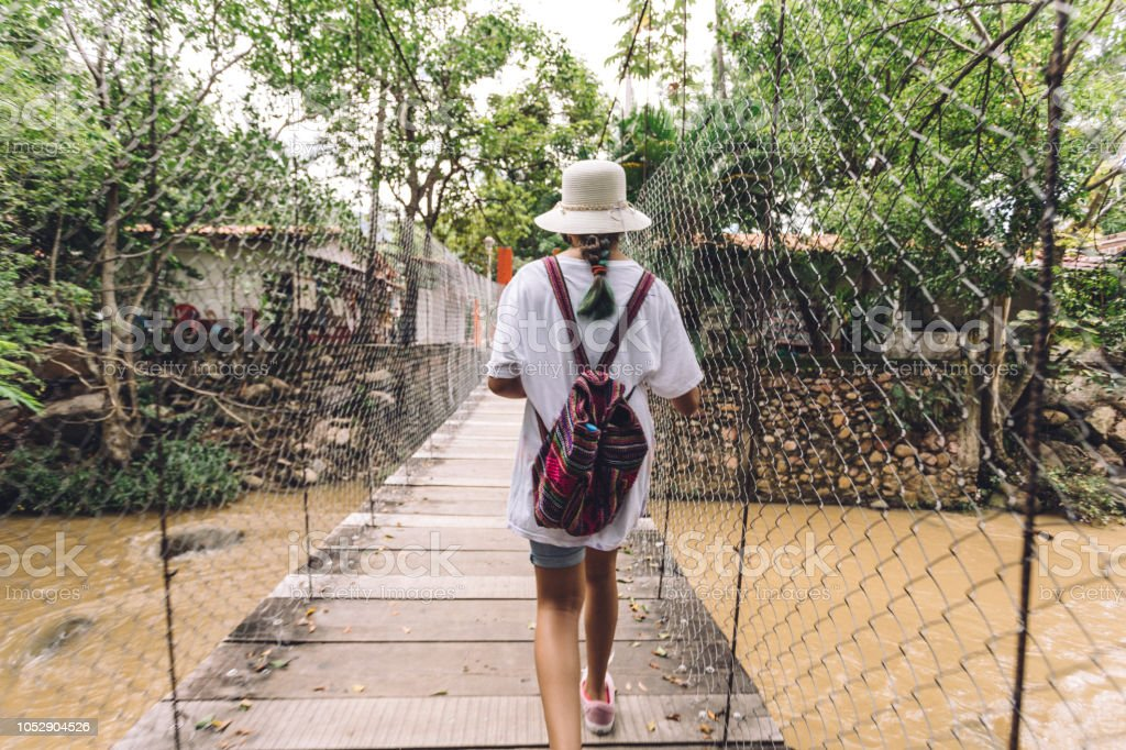 crossing a suspended bridge stock photo