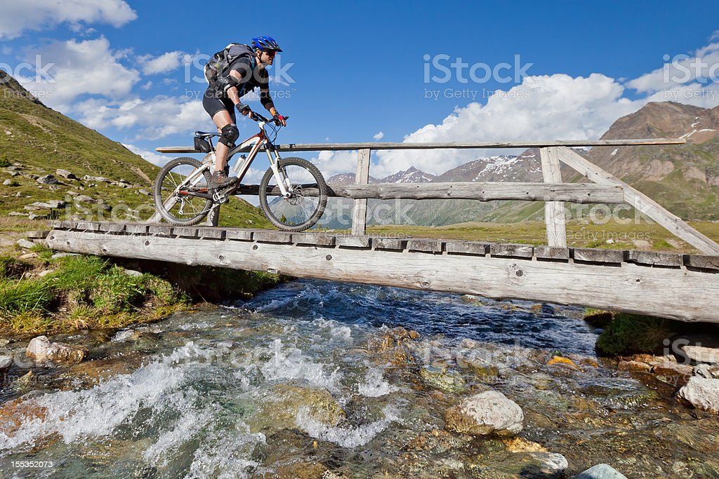 Crossing alpine creek, South Tyrol stock photo