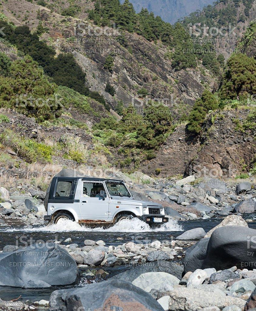 4WD crossing creek, Canary Islands, Spain stock photo