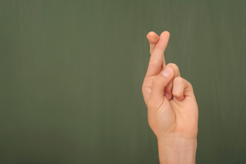 Crossing Fingers Stock Photo - Download Image Now