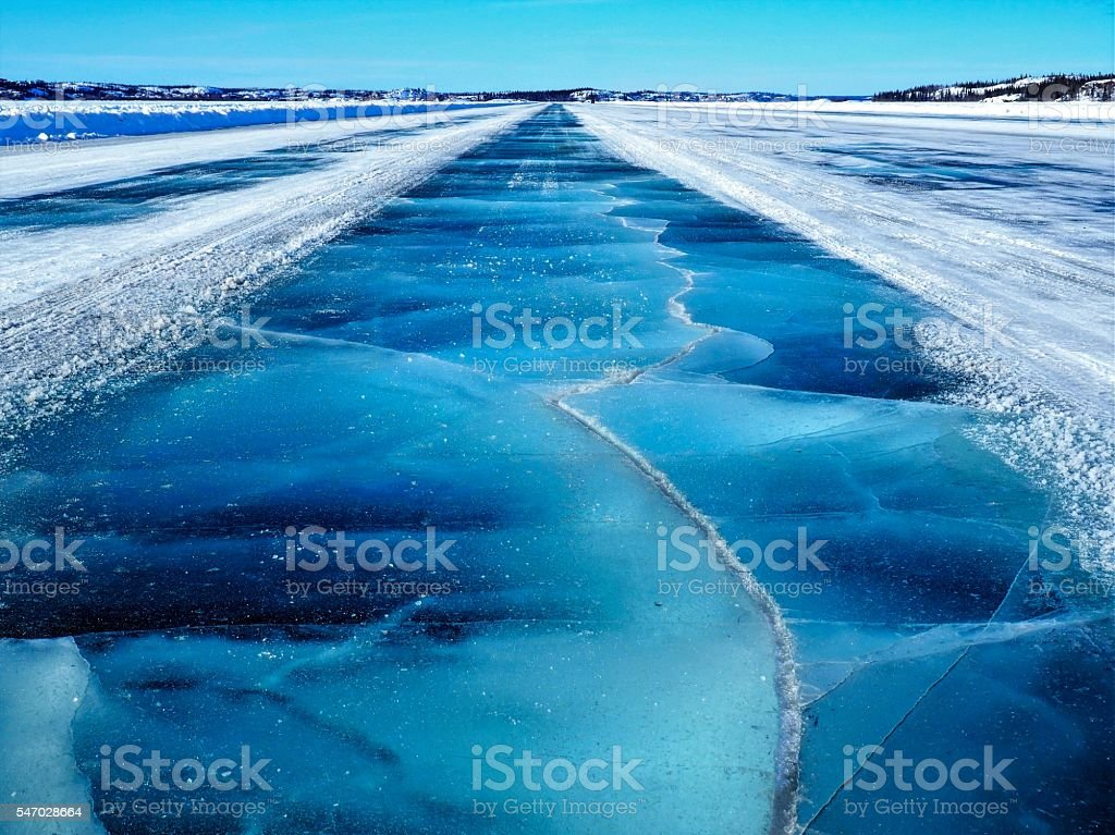 Crossing Frozen Cracked Blue Dettah Ice Road stock photo
